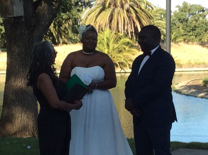 The couple with officiant