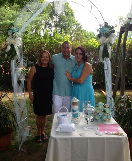 Newlywed couple with the officiant