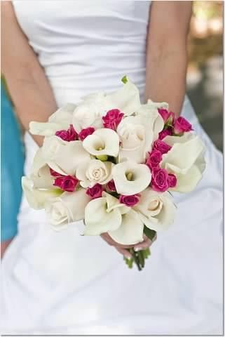Bride's bouquet with hot pink spray roses and white miniature calla lilies
