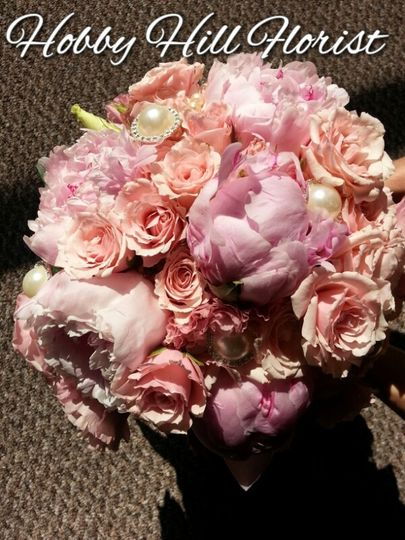 Bride's bouquet peonies, spray roses and brooches
