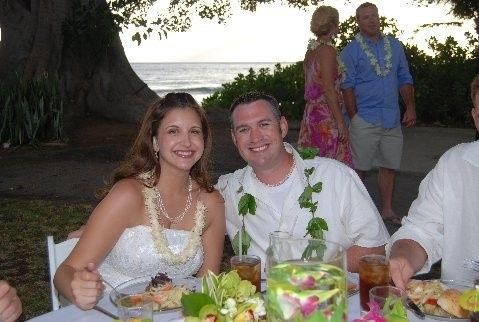 Newlyweds enjoying their dinner next to the ocean at Olowalu Plantation Estate