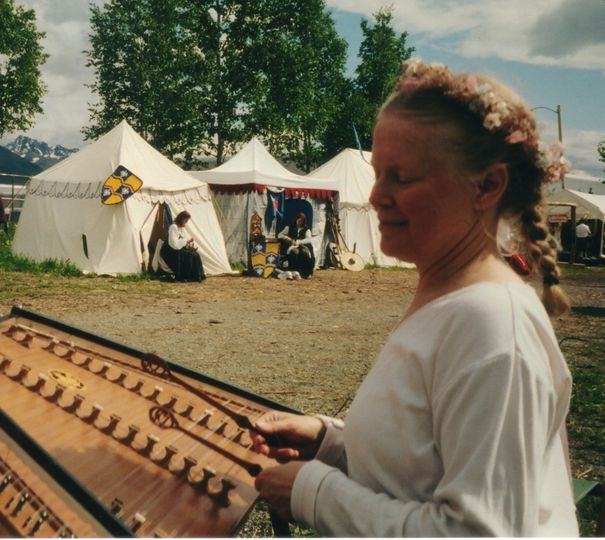 Denise playing at the Three Barons Rennaissance Fair.