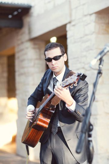 Aaron Goldfarb performing at a wedding ceremony at the Ladybird Johnson Wildflower Center in Austin,...