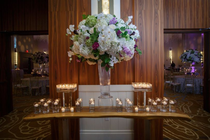 Candles and raised floral centerpiece