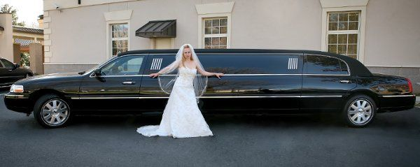 Bride with Traditional Black Lincoln Stretch Limousine
