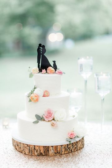 3-tier cake with newlyweds figurine