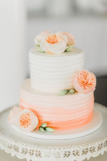White to peach ombre wedding cake