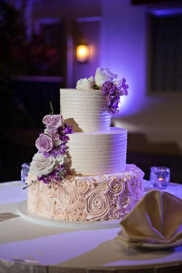 Floral wedding cake with purple flowers