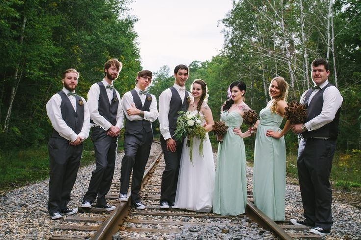 Newlyweds with groomsmen and bridesmaids