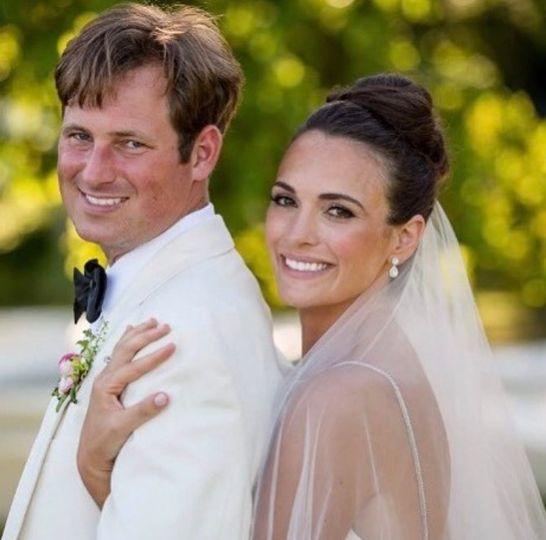 Hugging her groom | Randall Garnick Photography