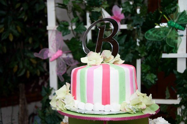 This cutting cake sits atop a cupcake tower