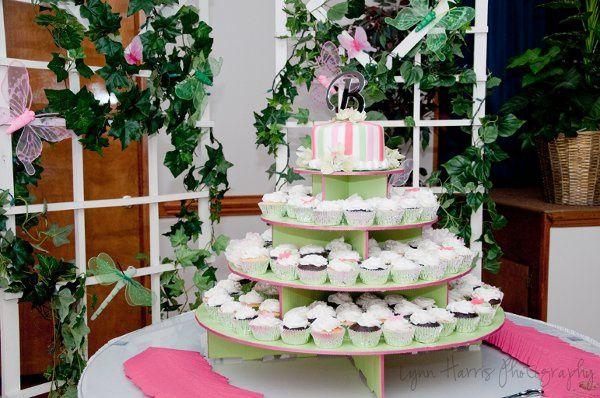 "Cupcake tower wedding cake with a 6"" round cutting cake"