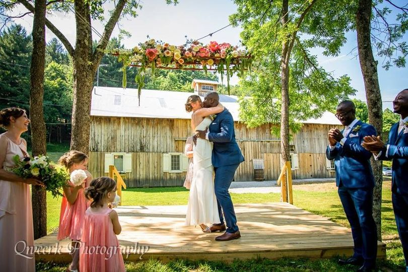 Newly wed couple share their first kiss