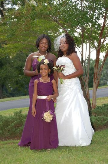 The bride with bridesmaid and a kid