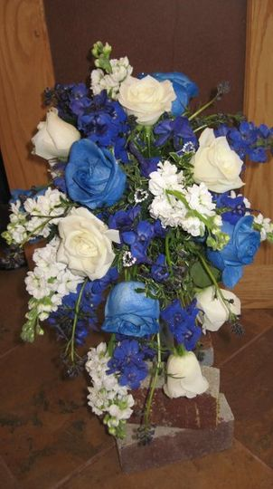 Cascading bridal bouquet with blue roses.