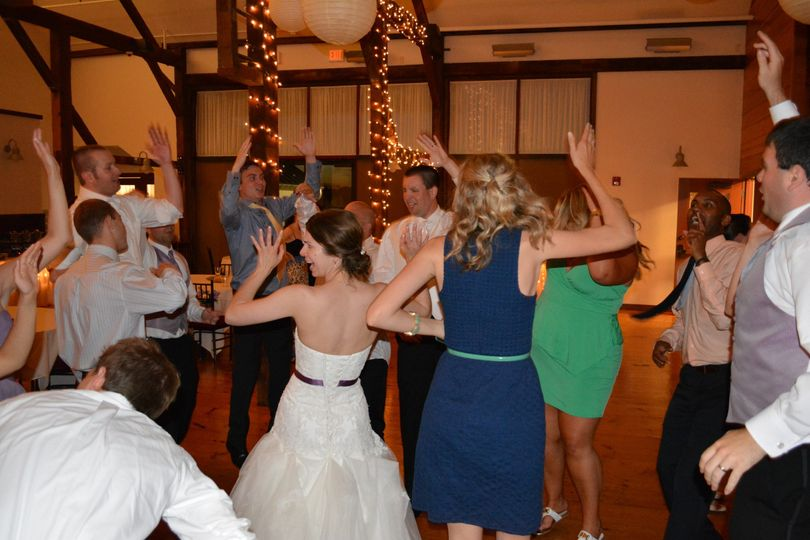 Couple and guests dancing