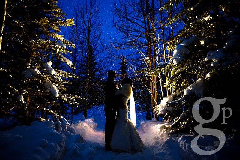 Night wedding kiss in the snow.