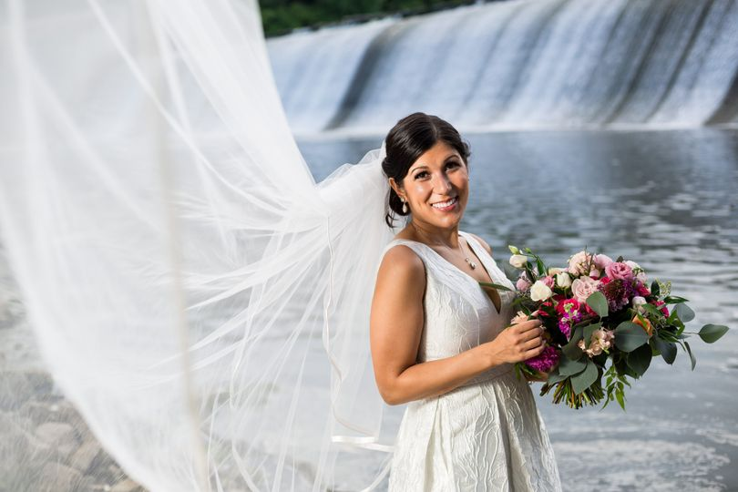 Bride by a waterfall
