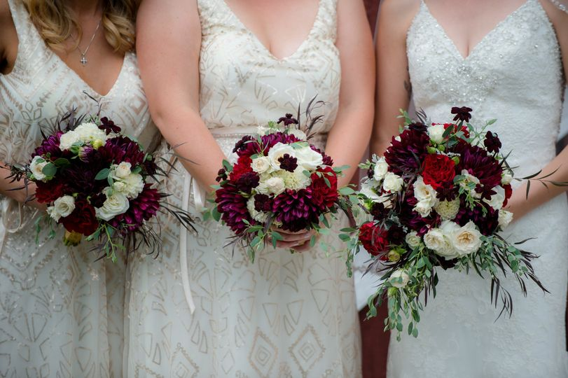 Bouquet of white, red, and violet flowers