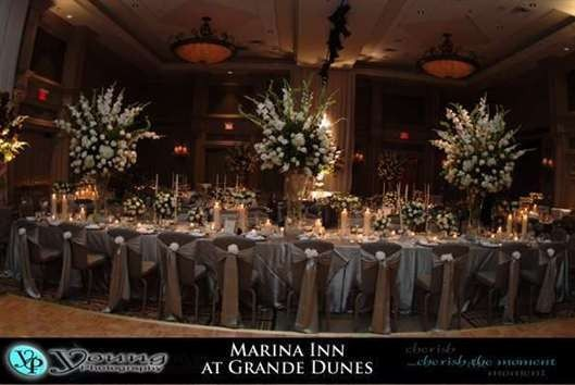 A beautiful classic head table setting in the Nautilus Ballroom that will accommodate up to 350 for...