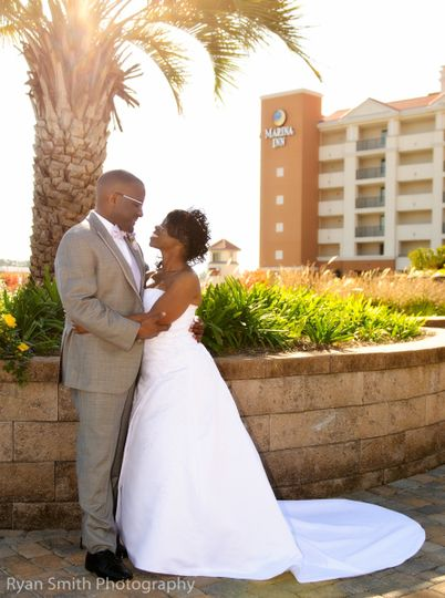 The exterior of the marina inn is a perfect site for evening photos of the bride and groom.