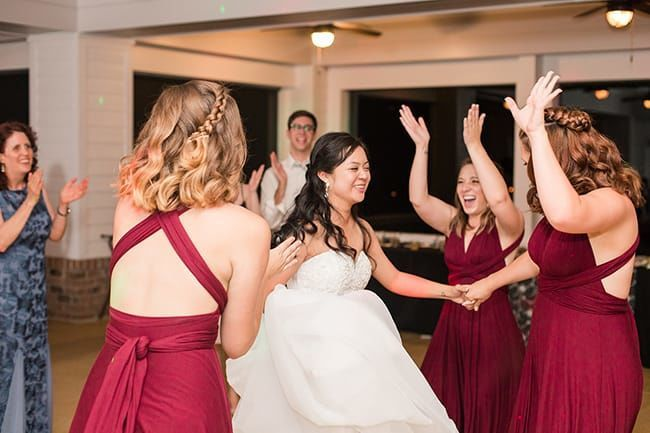 Bride and her court tearing up the dance floor.