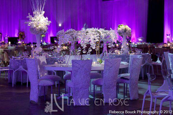 Tmx 1356135694649 Lavieenrosewhiteorchidtuliprosehydrengeacenterpiecenuagelinentseweddingdinner Tampa wedding florist