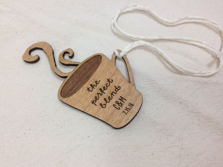 I love when couples give edible favors like jam or coffee at their reception. These engraved wood...