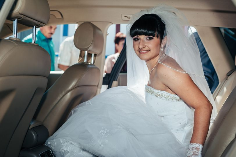 bride happy in limousine houston