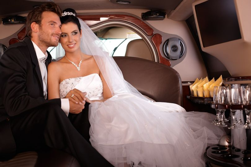 bride groom smiling in houston limo