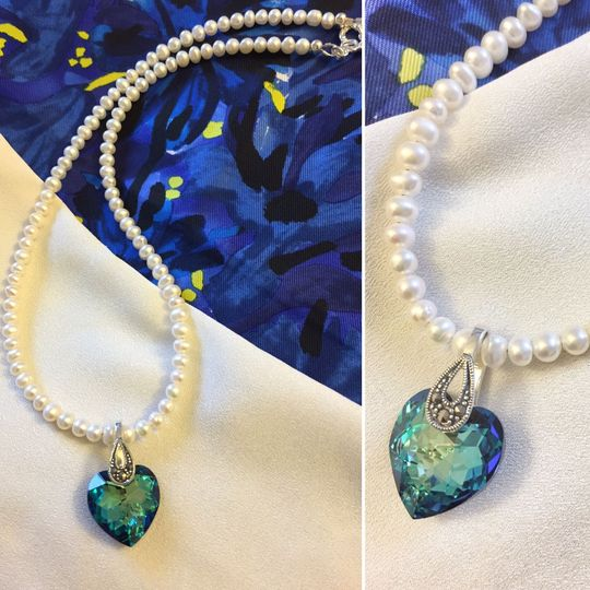 Freshwater pearls with a Swarovski crystal pendant in Bermuda blue, on a Stelring Silver and...