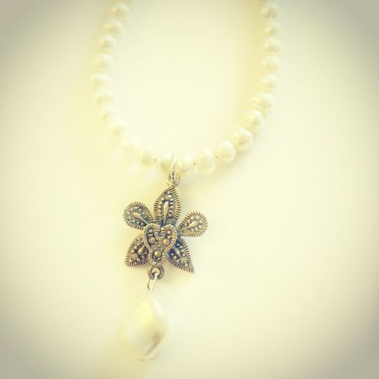 Freshwater pearls with a Sterling Silver and Marcasite Orchid flower and a Swarovski crystal curved...