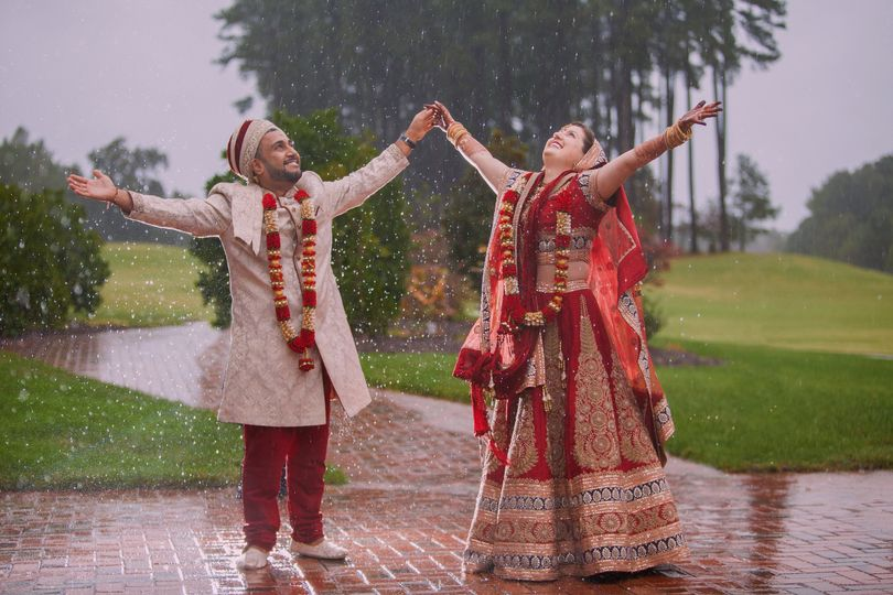 Newlyweds embracing the rain