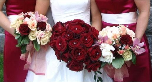 brides bouquet of Black Baccara roses accented with crystals. Coordinating attendants hand tied...