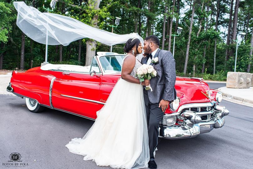 Newlyweds by the Vintage Car