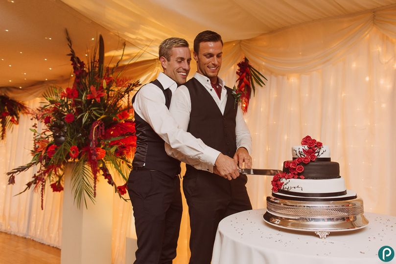 gay wedding cutting cake