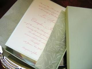 Soft pastel green boxed invitation with sculptured leaves wrap