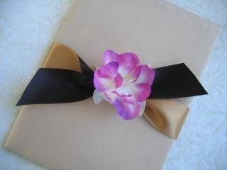 Silk folio tied with ribbon and silk flower