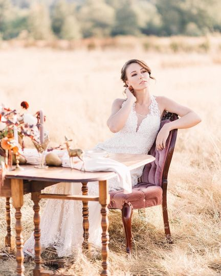 Bride posing in a field | Photo by Tetiana Photography