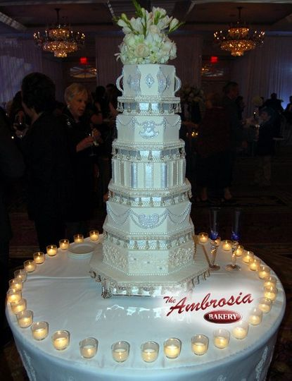 Beautiful 5 tier fondant wedding cake.  Cake layers are hexagon with small breaks in between layers...