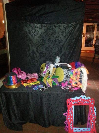 Our photo booth comes with a ton of fun props from hats, boas, wings, capes, mustaches on a stick,...