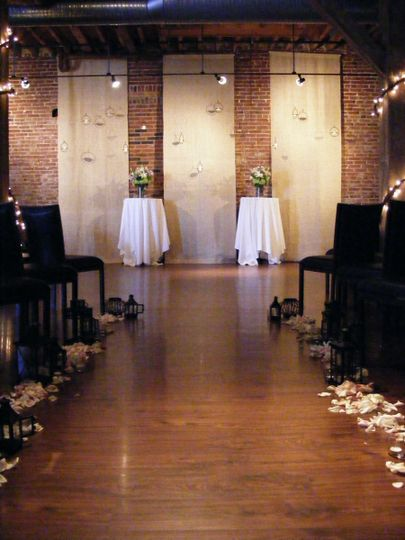 Ceremony in Chouteau Room w/ Bulap Panel Backdrop and hanging candles