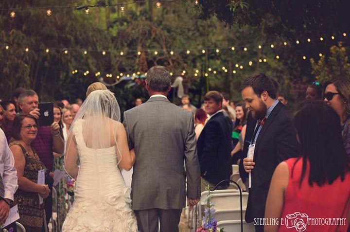 Outdoor wedding at the River Road and Jasmine Houses