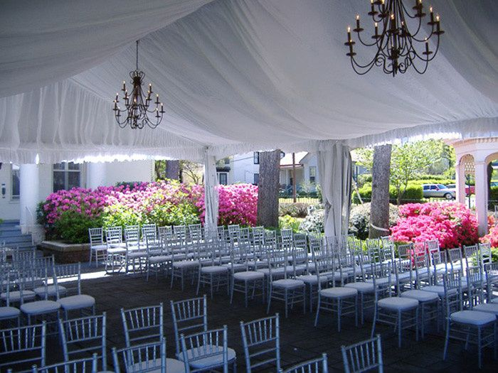 Tent and light draping with chivari chairs are just a small portion of what we can do.