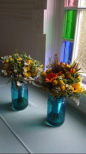 Flower arrangement placed in a blue jar