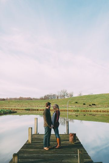 Couple celebrating their engagement by the stunning lake