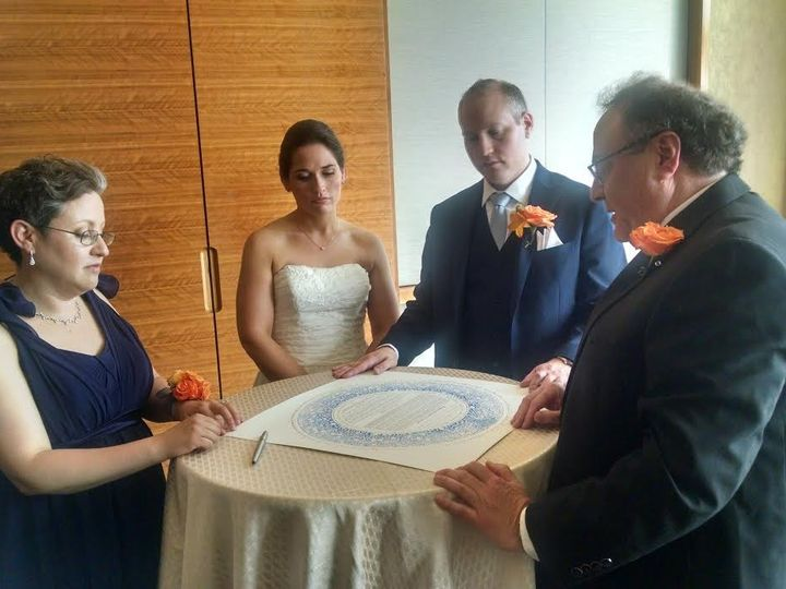 Tmx 1483482241142 Josh And Sienna 052816 Four Seasons Signing The Ke Baltimore, Maryland wedding officiant