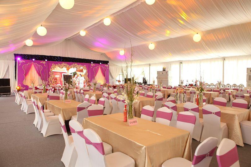 Full wedding tent accessories for romantic wedding ceremony.
