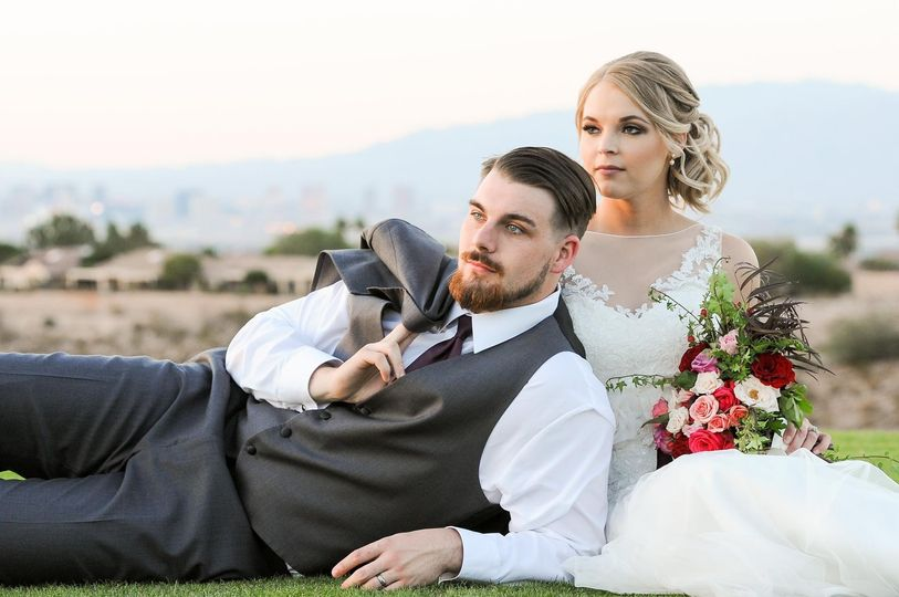 Groom lying by his bride's side