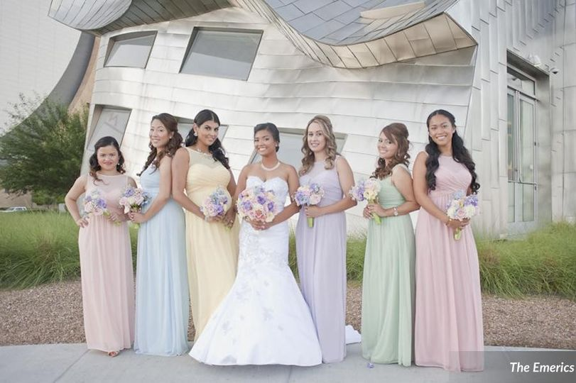 Bride and her bridesmaids in pastel dresses